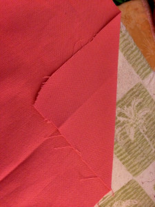 diagonal fold on bottom hem