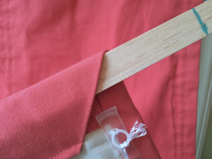 wooden slat in bottom hem