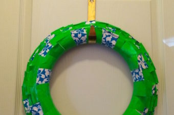 How to make a duct tape wreath with theme tape and foam wreath form. DIY pleated wreath to add to your Christmas crafts and family activities.