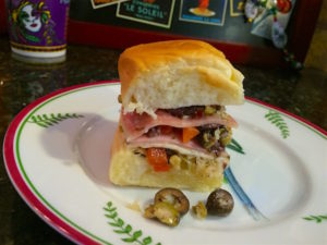 Muffuletta sliders, a New Orleans classic sandwich at a party. Italian olive salad, genoa salami, ham, Swiss, and provolone - tasty!