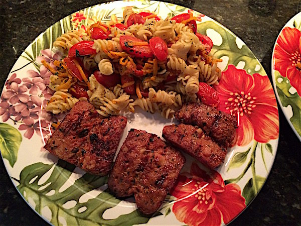 Carrot and tomato pasta with sausage make a gluten free, egg free pasta dinner. Great use of grape tomatoes. Full of flavor for 376 calories!