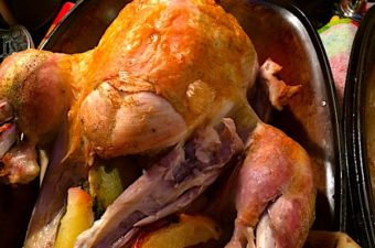 Roast turkey or pavo Latino style is cooked in a Romertopf clay pot with limes and cilantro. Gravy has white wine and arrowroot powder.