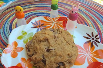 Dark chocolate chip cookies with orange use a chopped dark chocolate orange candy for surprise flavor. Oatmeal and walnuts also add flavor to this chewy cookie.