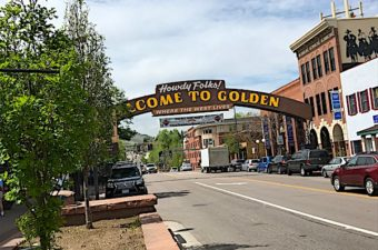 Golden Colorado in the foothills of the Rocky Mountains has whitewater Clear Creek running through town, Buffalo Bill, Coors, college life, and history.