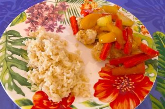 Healthy sweet and sour chicken gets flavor from marmalade and vinegar. Chicken is baked with an almond coating. Pineapples, peppers, and carrots round out the dish.