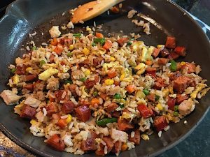 Easy fried rice at home Hawaiian-style local flavor gets flavor from meats and toasted sesame oil. Use brown rice and coconut aminos for clean eating.