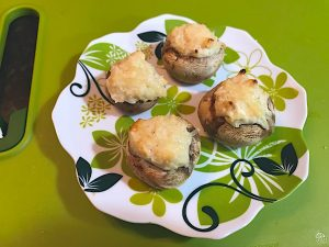 Cheesy mushroom appetizer is a savory vintage hot dish. Cream cheese, Parmesan, and spices add flavor.