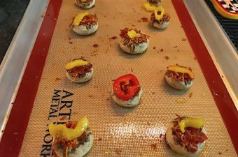 Nacho mushroom appetizer is a spicy vintage hot dish. Pepper jack cheese and pepperoni add flavor.
